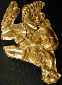 Guldgubber depicting a man in full swing with a sword